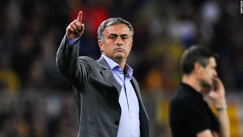 Jose Mourinho gestures during the El Clasico clash with his Barcelona counterpart Tito Vilanova in the background.