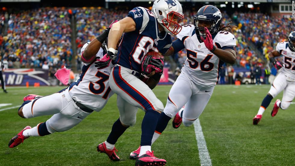 Wes Welker of the New England Patriots runs the ball on a punt return against the Denver Broncos.