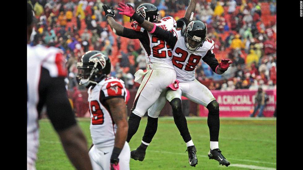 No. 25 William Moore and No. 28 Thomas DeCoud of the Atlanta Falcons celebrate after an interception late in the fourth quarter.