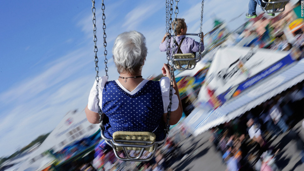 People dressed in traditional Bavarian clothing ride swings during Friday's festivities.