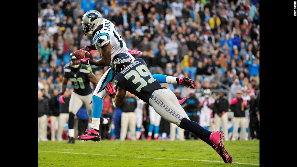 Brandon LaFell of the Carolina Panthers makes a leaping first-down catch against defender Brandon Browner of the Seattle Seahawks.