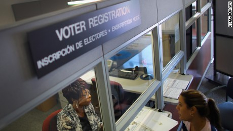 Dorothy Torrence, from the Miami-Dade Elections Department, helps Viviana Camacho with information about her voter registration in Miami, Florida.