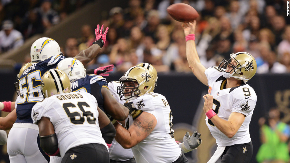 Quarterback Drew Brees of the New Orleans Saints throws a pass in the first quarter against the San Diego Chargers.