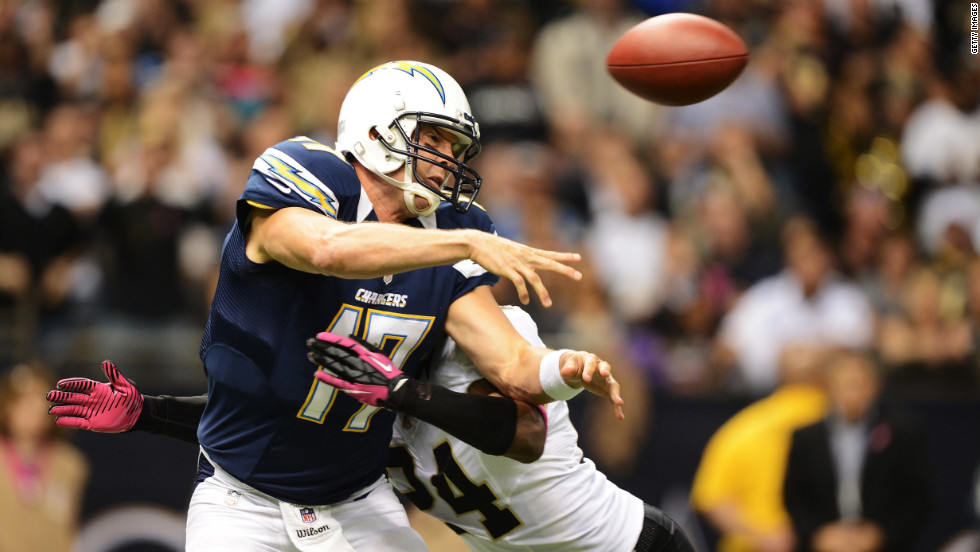 Corey White of the Saints hits Chargers quarterback Philip Rivers as he throws a pass in the first quarter.