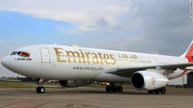 A picture taken on February 1, 2012 shows an A330-200 Airbus plane of Emirates airline at the Harare International Airport on February 1, 2012. Emirates Airline made its maiden flight to Harare today as it launched a new service between Zimbabwe, Zambia and Dubai. Zimbabwe's transport minister Nicholas Goche said the arrival of Emirates at a time many international airlines had stopped flights to Zimbabwe was 'a historical day for Zimbabwe. AFP PHOTO / JEKESAI NJIKISANA (Photo credit should read JEKESAI NJIKIZANA/AFP/Getty Images)