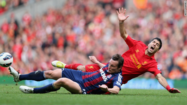 Liverpool's Uruguayan striker Luis Suarez (R) is one of the English Premier League's most controversial footballers
