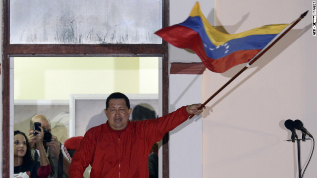OPSHOTS Venezuelan President Hugo Chavez waves a Venezuelan flag while speaking to supporters after receiving news of his reelection in Caracas on October 7, 2012.