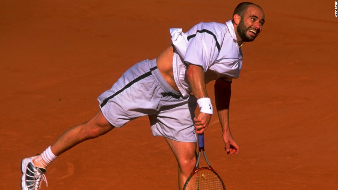 Agassi won his fourth major at the French Open in 1999 after coming back from two sets behind to beat Andrei Medvedev and complete a career grand slam.