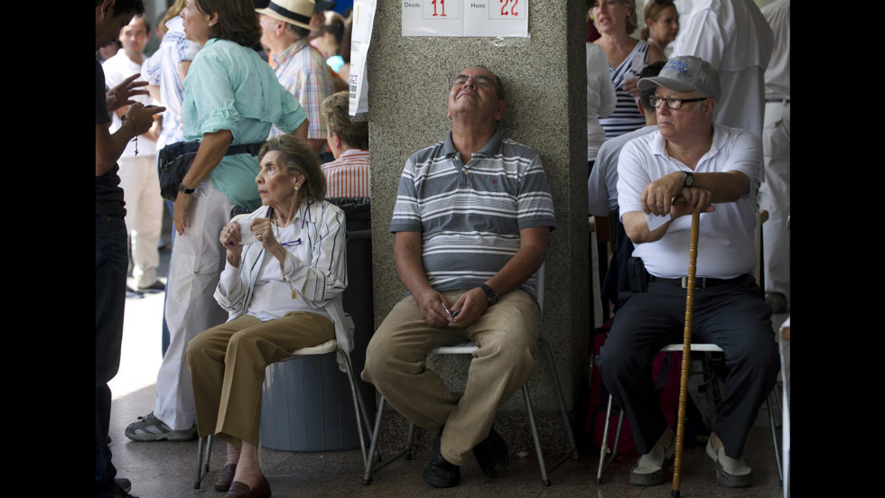 People wait to vote Sunday at a polling station in Caracas.