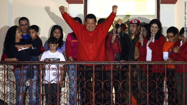 Venezuelan President Hugo Chavez (C) gestures while speaking to supporters after receiving news of his reelection in Caracas on October 7, 2012. According to the National Electoral Council, Chavez was reelected with 54.42% of the votes, beating opposition candidate Henrique Capriles, who obtained 44.47%. AFP PHOTO/JUAN BARRETO (Photo credit should read JUAN BARRETO/AFP/GettyImages)