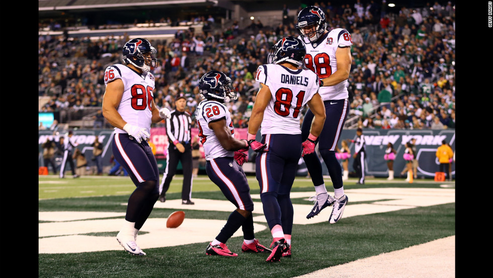 Owen Daniels is congratulated by his teammates.
