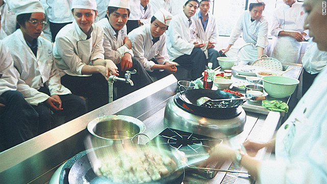 Dunlop watches a cooking demonstration with her classmates.