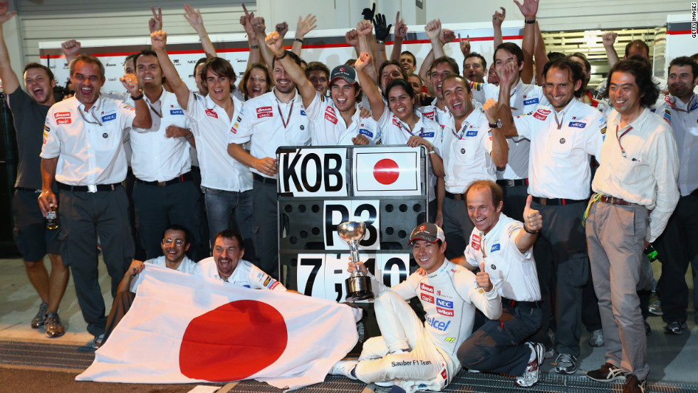 Kobayashi celebrates with teammates as Sauber close the gap on fifth-placed Mercedes in the constructors' championship.