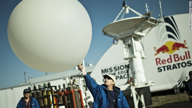 A crew member launches a weather balloon up to the stratosphere during the preparation for the final manned flight for Red Bull Stratos in Roswell, New Mexico on Thursday, October 4.