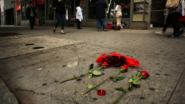 Roses are left next to where the body of Michael Jones, a New York Red Bulls soccer coach, was found early Sunday morning .