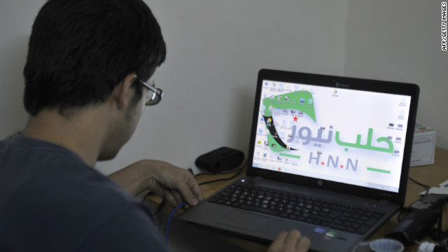 Abu Mahmud, a 20-year-old technician, looks at a laptop in the Syrian city of Aleppo on October 7, 2012.