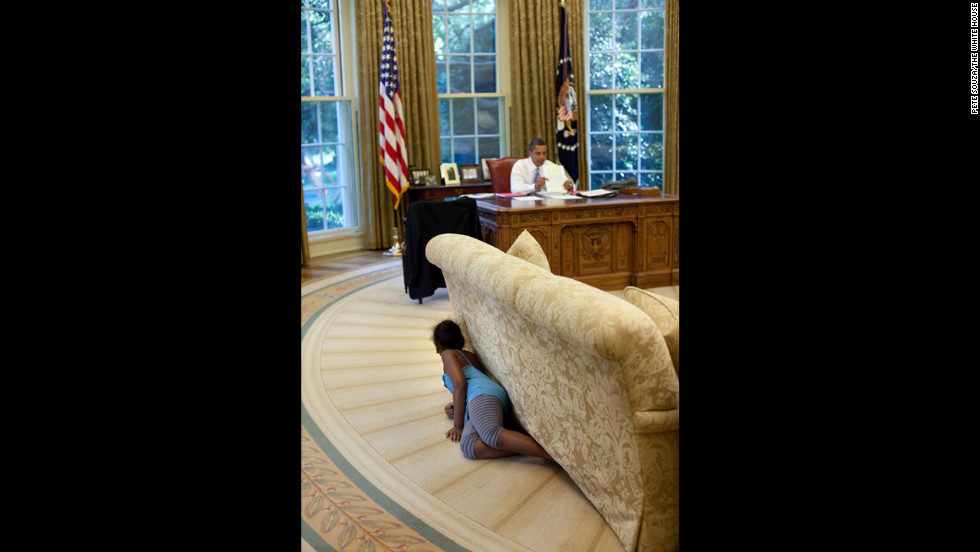 """I was sitting in the reception area outside the Oval Office on August 5, 2009, when Sasha walked by and headed to the Oval. I suspected something was up, so I followed her. Sasha then crawled into the office, hiding behind the sofa, and when she reached the far end, jumped up and yelled, trying spook her dad."""
