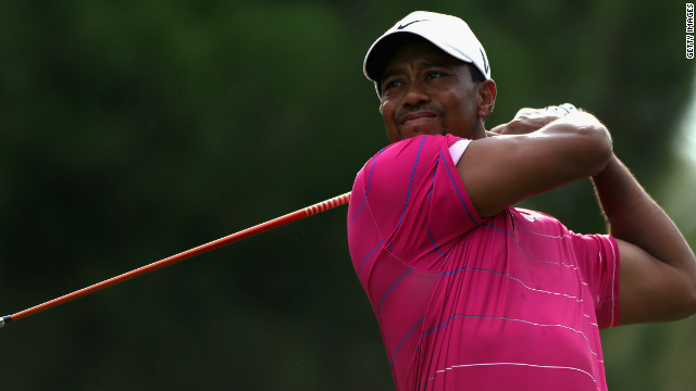 Tiger Woods tees off in his second match at the World Golf Finals as he beat Matt Kuchar in Turkey.