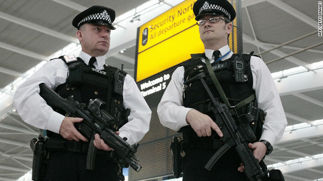 British police arrested a man and a woman at London's Heathrow Airport as part of an investigation into travel to Syria for alleged terror activity.