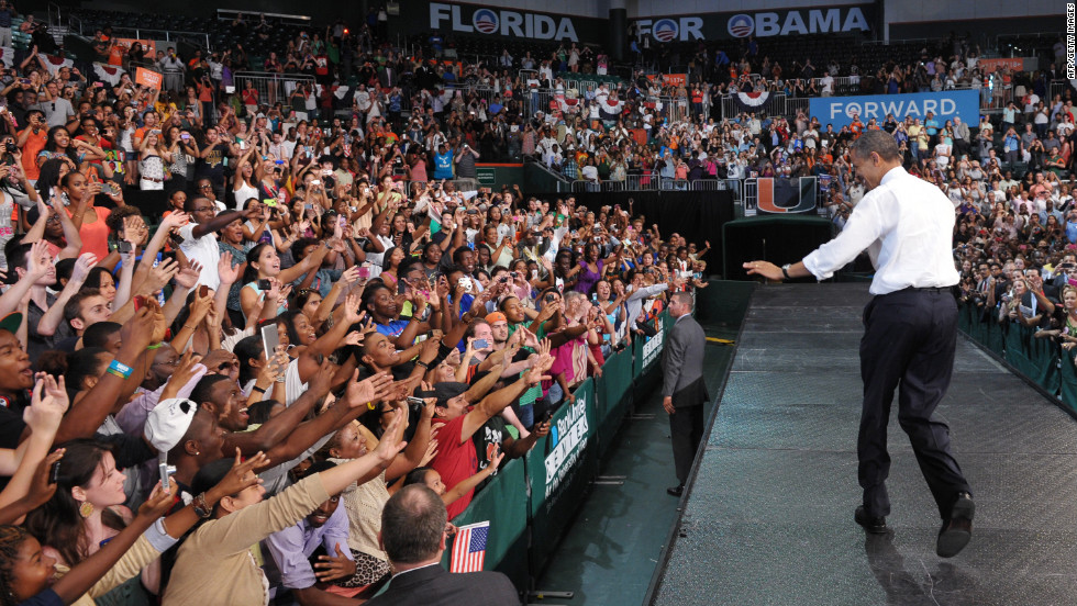 Obama greets supporters at a campaign rally at the University of Miami on Thursday.