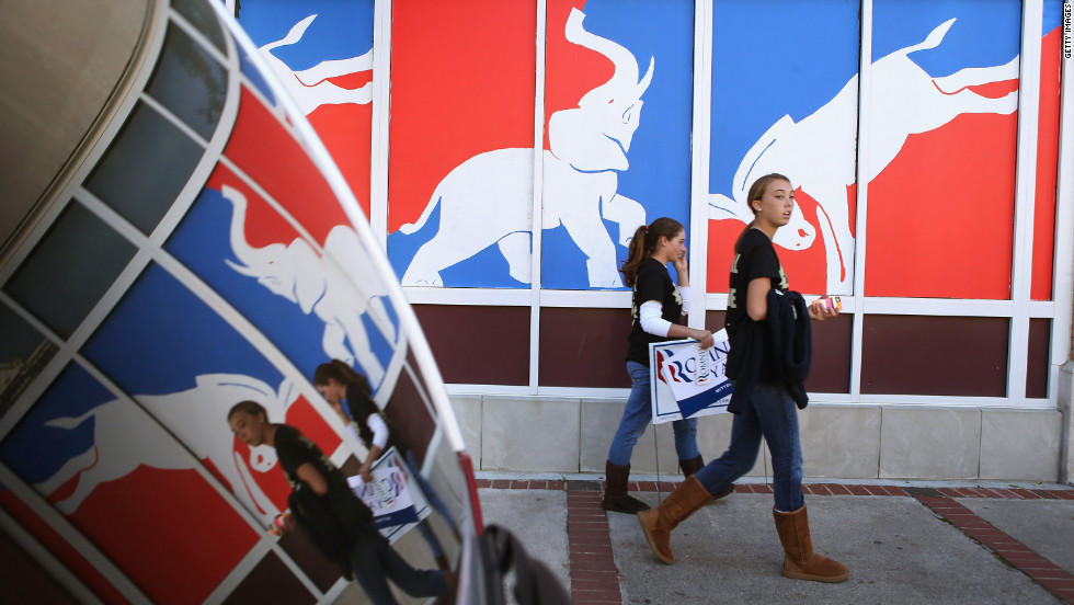 Students walk past a political mural near Centre College in downtown Danville, Kentucky, where Vice President Joe Biden and Republican vice-presidential nominee Rep. Paul Ryan faced off Thursday, October 11.