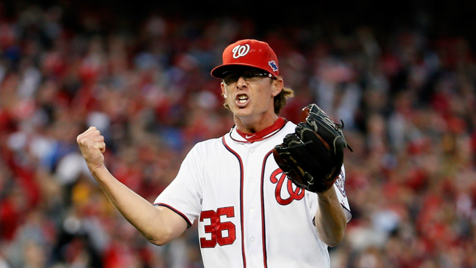 Pitcher Tyler Clippard of the Washington Nationals exults after striking out the side in the eighth inning Thursday at Nationals Park.