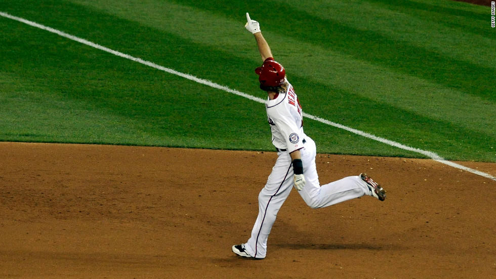The Nationals' Jayson Werth celebrates as he rounds first base after hitting a walk-off home run in the bottom of the ninth inning Thursday against the Cardinals to even their series at two games apiece.