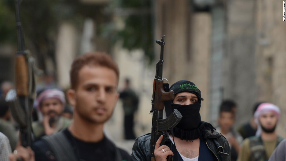 Syrian opposition fighters walk in the streets of Aleppo on Thursday.