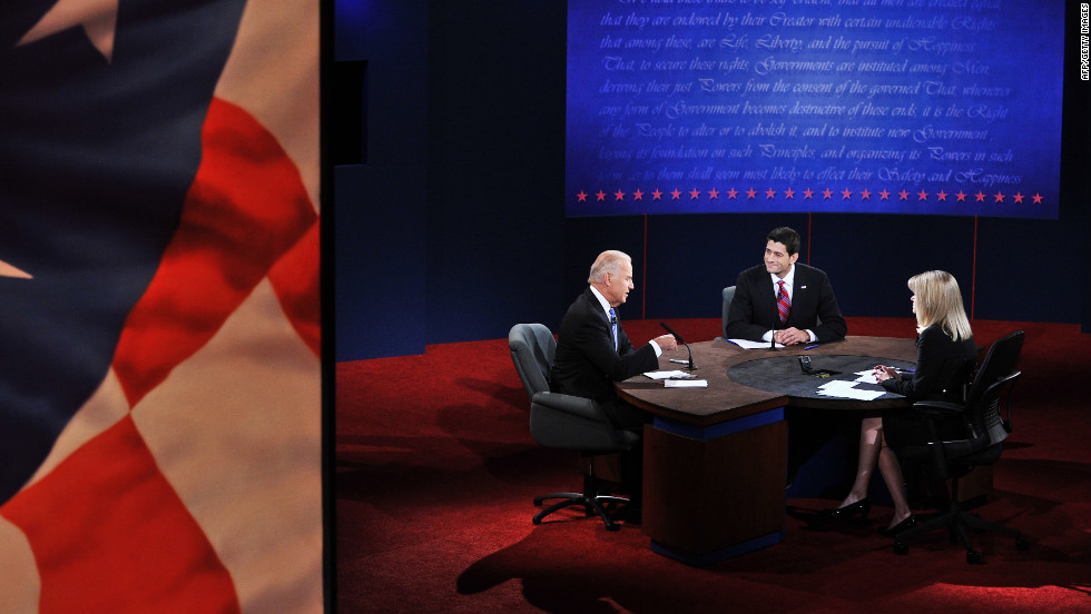 U.S. Vice President Joe Biden, left, engages in the first and only vice presidential debate on Thursday, October 11.