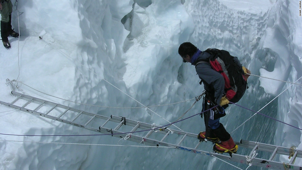 Hair-raising activities like this ladder crossing at the Khumbi ice fall near the base of Mount Everest are a world away from Samra's previous career as an investment banker in London and Hong Kong.