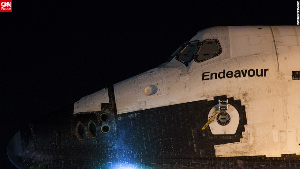 "CNN iReporter Wes Smith and other space enthusiasts got a close-up view of the space shuttle Endeavour early Friday as it makes its final journey from Los Angeles International Airport to the <a href=""http://www.californiasciencecenter.org/"" target=""_blank"">California Science Center</a>. Smith says he saw the shuttle about 5 a.m. after waiting in a Los Angeles parking lot across from Endeavour's overnight holding area."