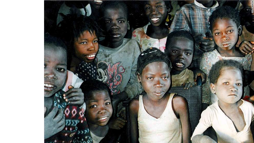"Farrow took this image of a group of children in Angola in 2002.  At the time, the girl in the middle was 17 years old. ""Wherever I go,"" Farrow says, ""I am always struck by the children. In the face of their courage, resilience and hope, I don't see how we can allow ourselves the luxury of feeling overwhelmed or helpless."""