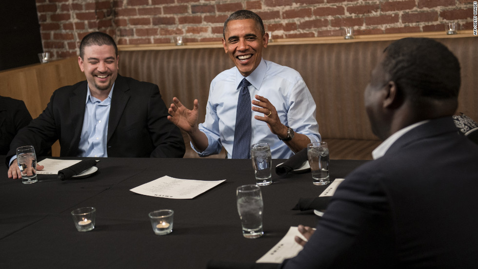 Mario Orosa, left, and Ron Cathey, right, chat with Obama during dinner at Smith Commons restaurant in Washington on Friday, October 12. Obama had dinner with contest winners who contributed to his re-election campaign.