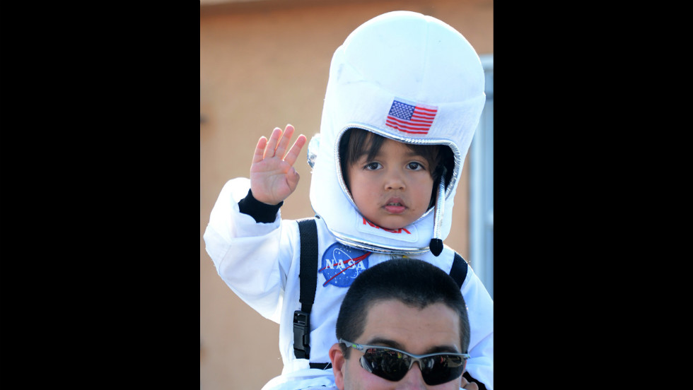 A 4-year-old named Levi watches Endeavour make its way down a city street on Saturday.