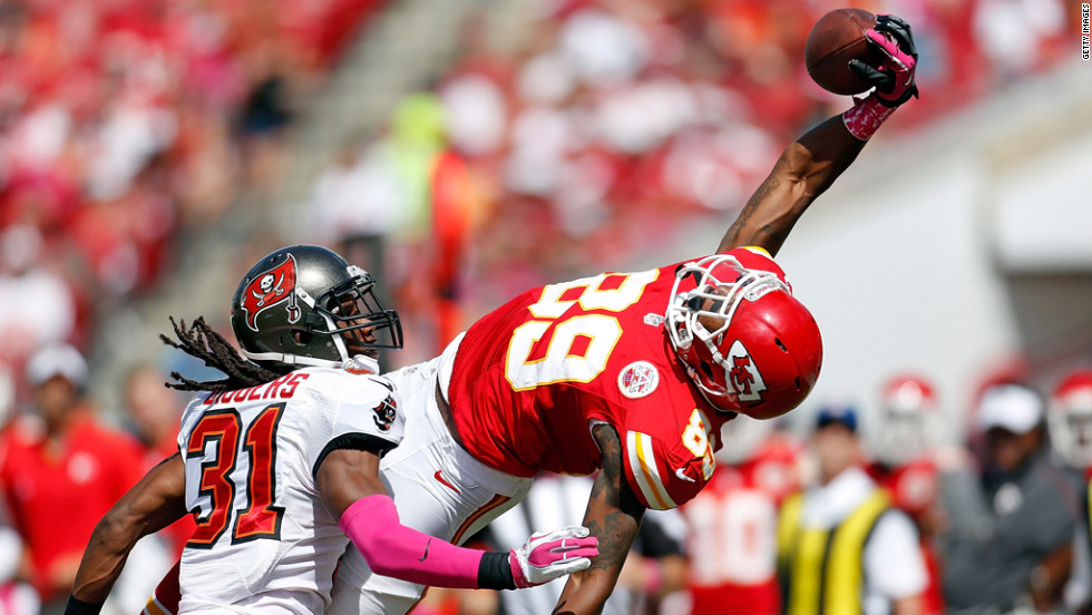 Jon Baldwin of the Kansas City Chiefs tries to make a catch against defender E.J. Biggers of the Tampa Bay Buccaneers on Sunday at Raymond James Stadium in Tampa, Florida.