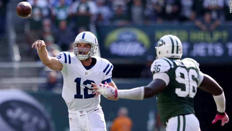 Colts quarterback Andrew Luck fires a pass under pressure from Muhammad Wilkerson of the Jets.