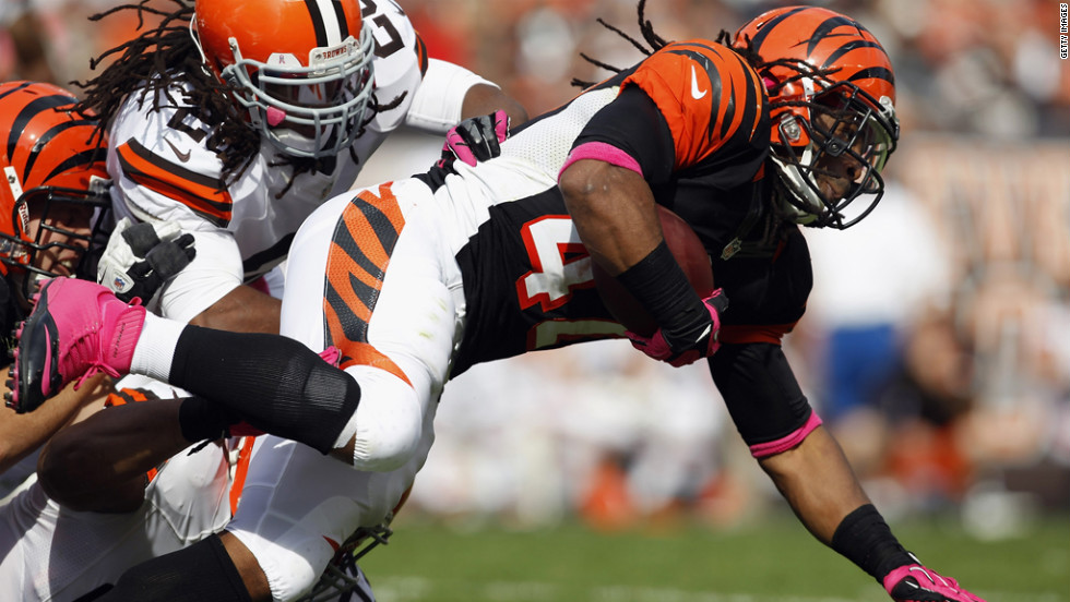 BenJarvus Green-Ellis of the Cincinnati Bengals is hit by Cleveland Browns defenders.
