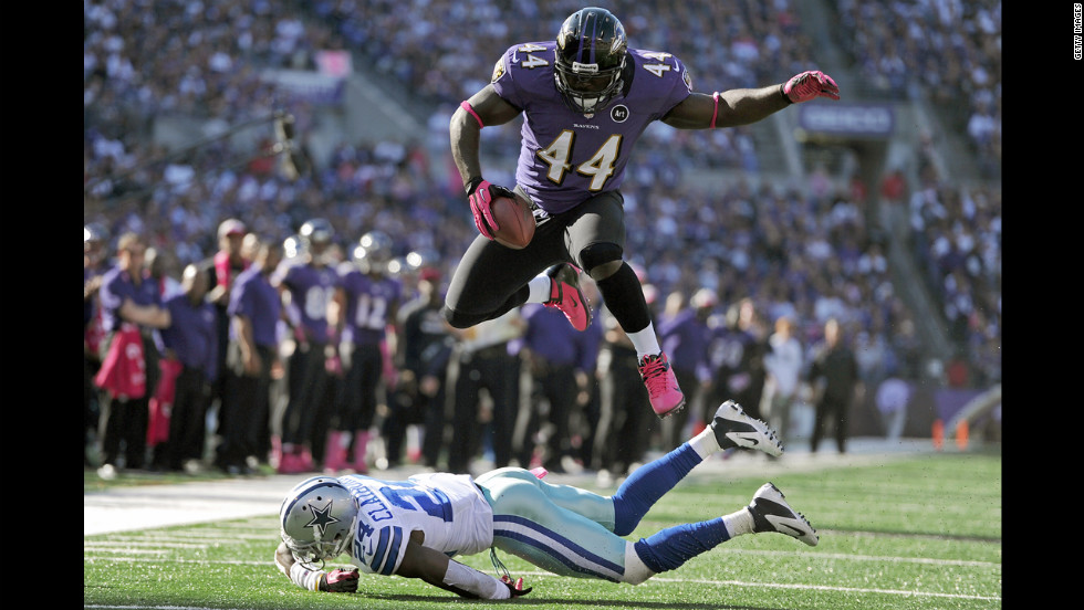Vonta Leach of the Baltimore Ravens leaps over Morris Claiborne of the Dallas Cowboys before being hit out of bounds in the fourth quarter Sunday.