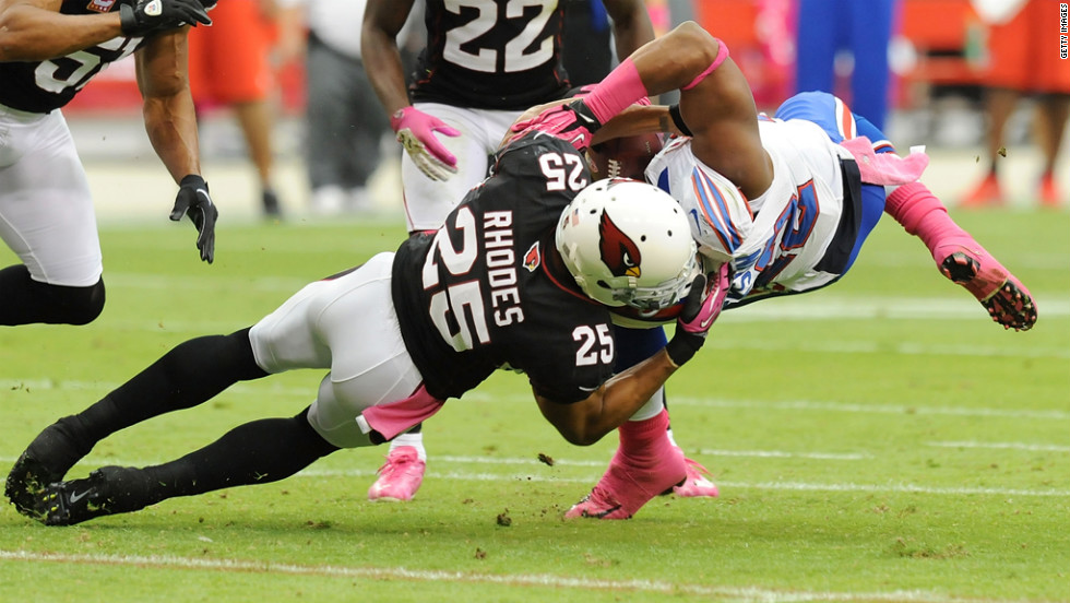 Kerry Rhodes of the Arizona Cardinals tackles Fred Jackson of the Buffalo Bills.