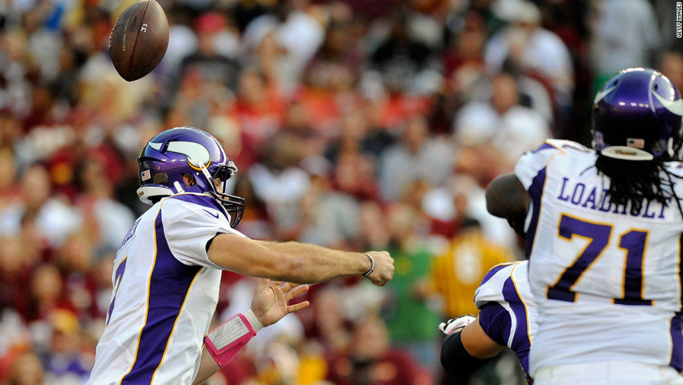 Vikings quarterback Christian Ponder fumbles the ball in the second quarter against the Redskins.