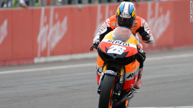 Dani Pedrosa clenches his fist after taking the checkered flag in the Japan MotoGP at Motegi.
