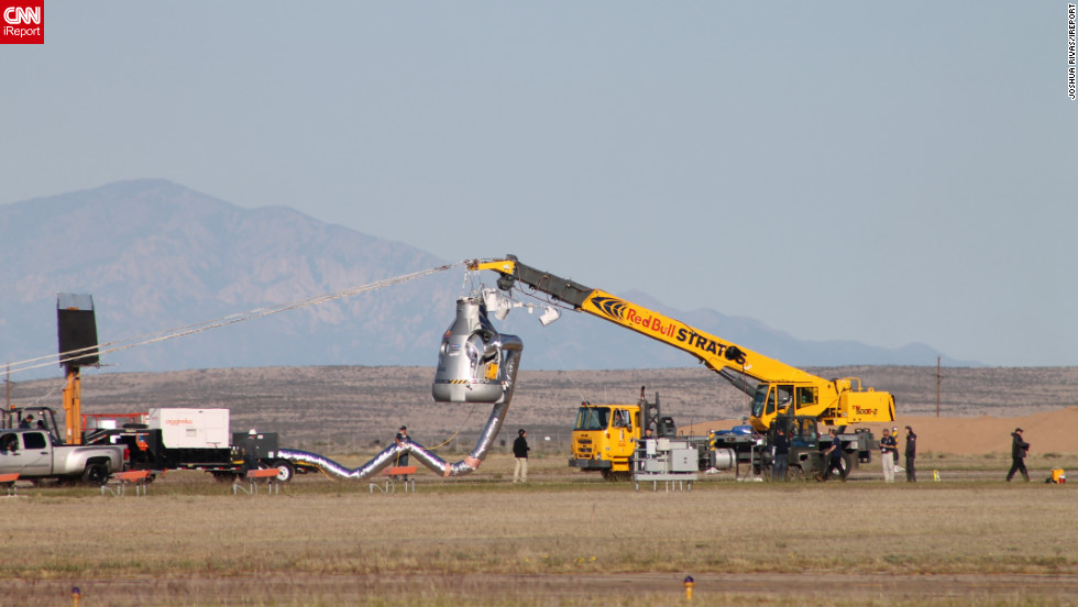 "<a href=""http://ireport.cnn.com/docs/DOC-858210"">CNN iReporter Joshua Rivas</a> watched crews prepare the capsule before sending Baumgartner into the air."