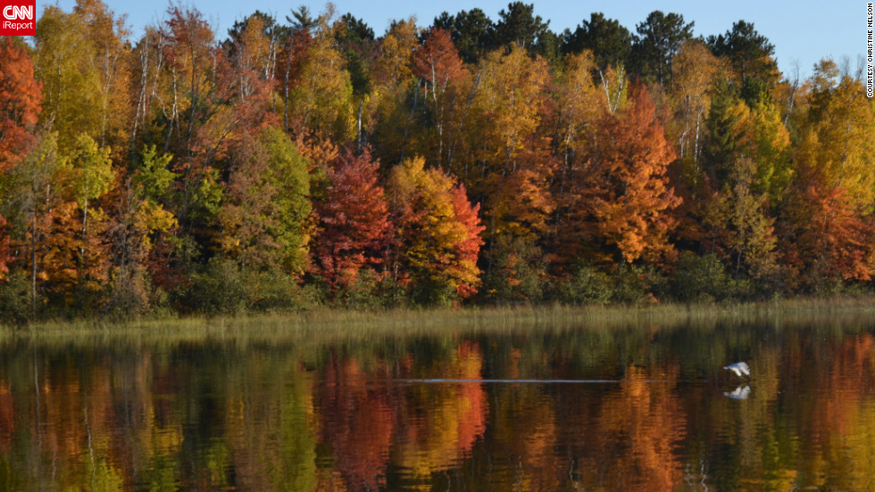 "Autumn color is reflected in <a href=""http://ireport.cnn.com/docs/DOC-856535"">Ely Lake</a> in Minnesota."