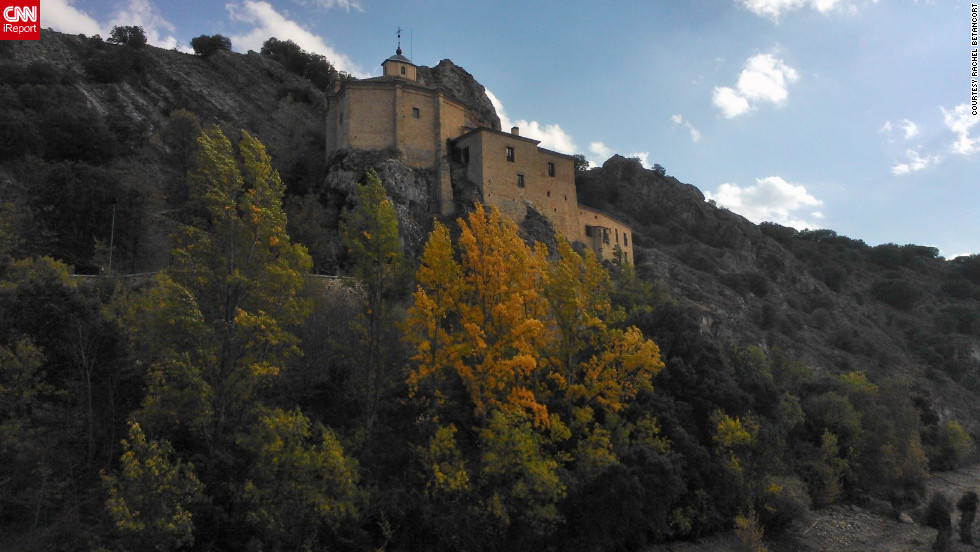 "Fall leaves highlight a 13th-century church perched on a cliff in <a href=""http://ireport.cnn.com/docs/DOC-853517"">Soria, Spain</a>."