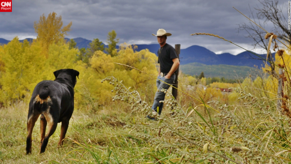 "Stephan Ferry and his dog, Java, enjoy the yellow leaves of fall in their <a href=""http://ireport.cnn.com/docs/DOC-858166"">Whitefish, Montana,</a> backyard."