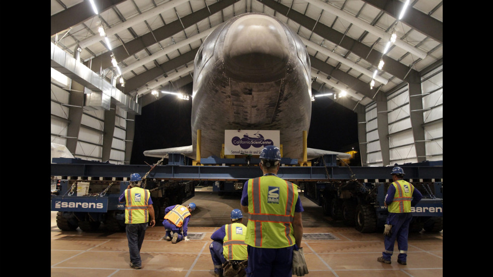 The crew carefully guides the space shuttle Endeavour into its new home at the California Science Center in Los Angeles on Sunday, October 14. Endeavour completed a 12-mile journey from Los Angeles International Airport to the science center where it will go on permanent public display.
