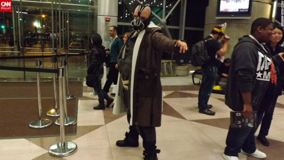 "Don't worry, Bane's not robbing a bank here. But fans dressed as the ""Dark Knight Rises"" character were seen in many of the iReport photos from New York Comic Con.<a href=""http://ireport.cnn.com/docs/DOC-857175"" target=""_blank"">See the full collection of photos on Diane Abela's iReport</a>."