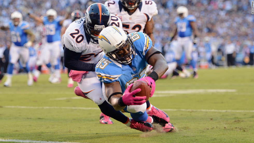 Antonio Gates of the San Diego Chargers dives into the end zone for a touchdown.