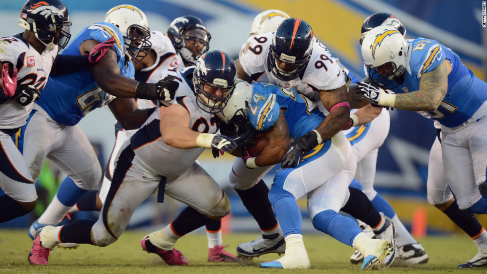 Defenders with the Broncos tackle Ryan Mathews of the Chargers.