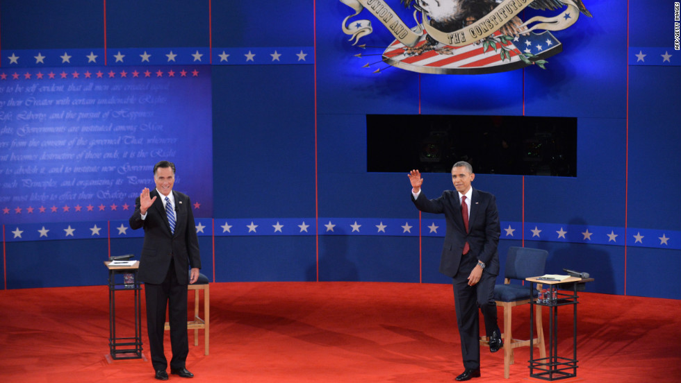 U.S. President Barack Obama and Republican presidential nominee Mitt Romney greet the audience.